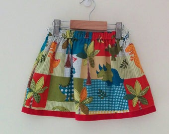 size 4 dinosaur skirt with elasticised waist and contrast trim and internal pockets *READY TO POST*