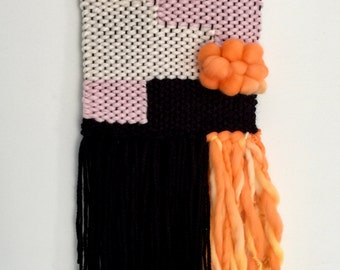 Woven wall hanging orange, pink, black and white. ON SALE.