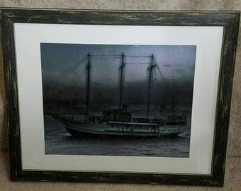 Old ship, black & white, 10x13 in a distressed wooden frame, 16x20.