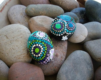 Handpainted rocks. Dots with dragonfly