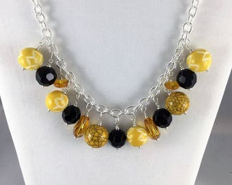 Chunky yellow and black swag necklace