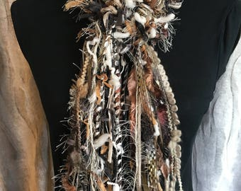 Unique fashion scarf in shades of black, brown, cream, taupe, white and grey.