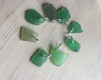 8x genuine sea glass pieces, shades of green, ideal charms, jump ring included, drilled
