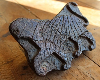 Old carved wood textile printing block of a tiger
