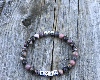 Black Rhodonite with white letters