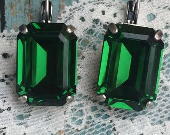 Swarovski emerald cut 18x13 dangle earrings set in antique silver.
