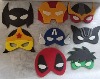 12 Superhero edible fondant toppers.