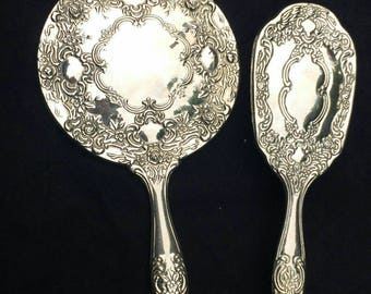 Vintage silver plate heavy vanity set to include hand held mirror and brush