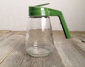 CLEARANCE: Federal housewares vintage syrup dispenser with green lid.