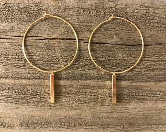 Gold hoop earrings with square bar
