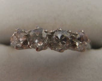 Lovely antique 4 diamond ring in 18 carat white gold