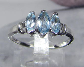 925 sterling silver ring with 3 topaz blue azure