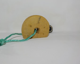 Vintage fishing net float with string.
