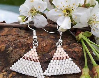 Earrings are made of miyuki beads.
