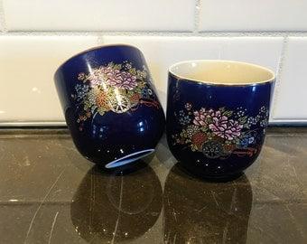 Pair of Kutani Cobalt Blue Teacups, floral wagon with gold rim