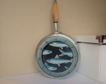 Object wall decoration sardines handpainted on old saucepan.