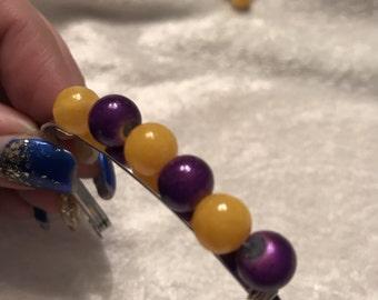 Purple & Yellow cuff bracelet.