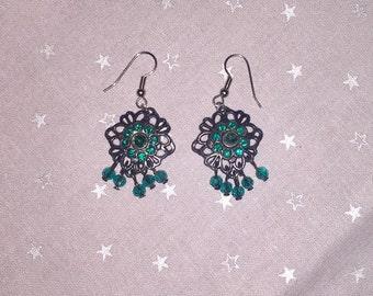 Black and green dangle earrings