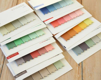 Memo pad/sticky notes in 5 different color shades listed and numbered lists
