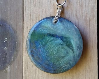 Necklace: Silver Sea; double-sided blue, green, silver resin pendant on silvery chain