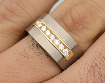 Titanium and 14 karat yellow gold Gents ring with simulated diamonds