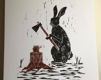 Two colour black and brown lino print of a Hare chopping wood. Original, hand printed and each one unique!