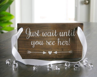 Just wait until you see her sign, ring bearer sign, here comes the bride sign, wedding sign