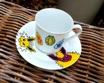Eevee evolution, vaporeon, Flareon, jolteon/ Pokemon hand painted ceramic tea cup and saucer