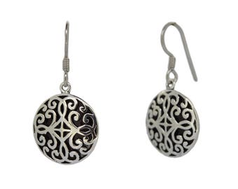 Hand crafted oxidised earrings with cotton tassles.