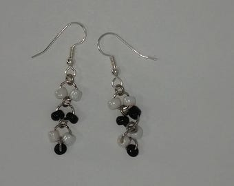 Custom hand made earrings black and white coloured glass beads