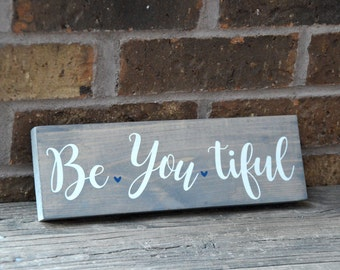 Rustic Be You tiful wooden sign.