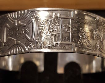 Embossed sterling silver Chinese theme bangle