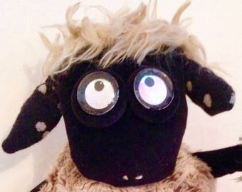 Original puppet and cute black sheep Wilfried