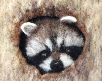 "At Home - needle felted racoon picture in a 13"" x 13"" frame"