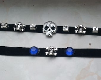 Silver Skull and Crossed Bones choker, bracelet, and earrings jewelry set