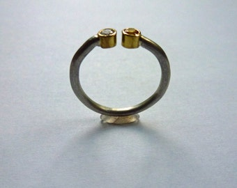 Open silver ring with diamond and sapphire in 14 ct gold version