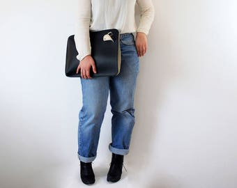 Cover broken and black white leather bag