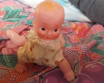 Vintage stringed doll