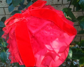 Red ruffled with NAPPY COVER.