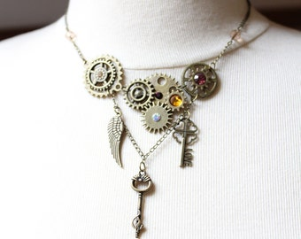 Antique bronze color steampunk necklace with gears and multicolor rhinestones