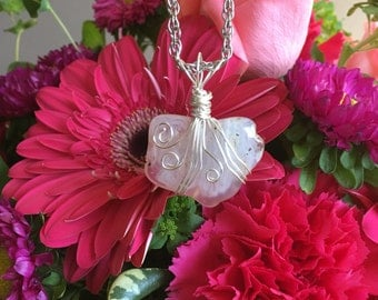 Pink Chalcedony wire wrapped pendant on chain.