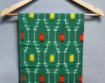Green red geometric abstract kasuri wool. Vintage kimono wool material. Retro Japanese craft material / fabric scraps