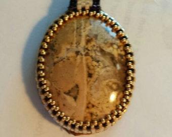 Peyote stitched cabochon