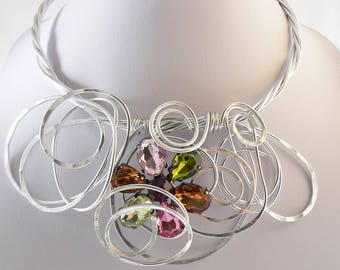 Unique silver wire necklace.Bib style,modern and abstract.Pink,green and bronze.