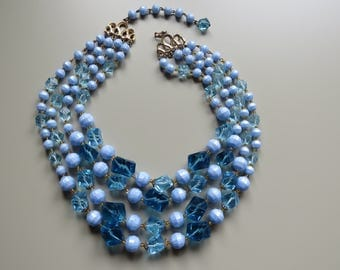 Wonderful vintage baby blue four strand necklace.  Very elegant addition to your jewellery collection.