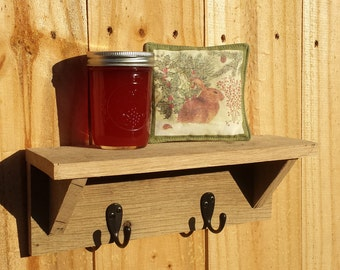 Small shelf with hooks