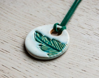 Pavo - ceramic pendant with a feather