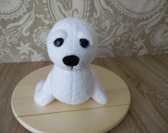 Seal, plush animal. 26cm high and 32cm long. NEW.