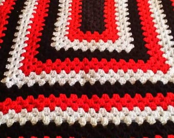 Red, black and white afghan