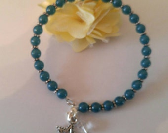 Fun, dark tealanssilver beaded braclet with star charm. Adult size. Made with memory wire and had lobster claw clasp.